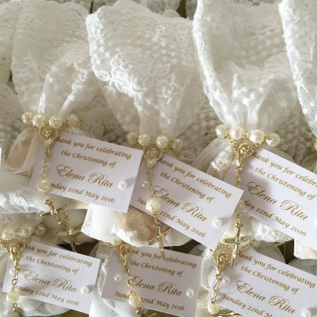 White lace bonbonniere bags with mini rosary beads