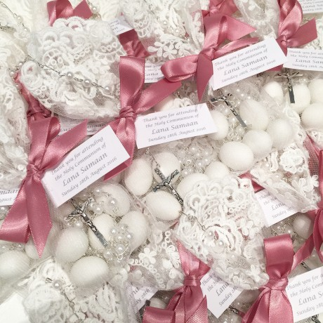 White lace bonbonniere bags with rosary bead